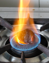 heating coal on flame