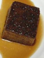 a piece of sticky toffee pudding on a plate