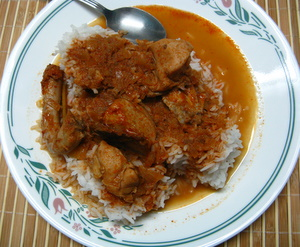 thai red chicken curry with rice on a plate
